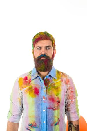 Painter. Serious bearded painter in shirt in paints. Construction worker in messy shirt. Industry man in paint dirty shirt. Decorator painter worker with hair and beard dirty in paints. Art concept.