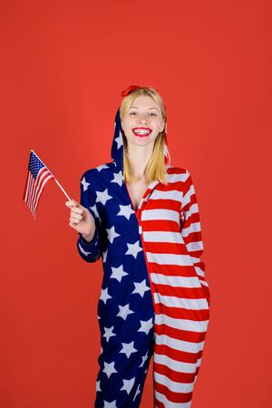 Independence Day. American flag. America. United states. USA. United states of America. US. July 4th. Summer. Smiling woman holding American flag.