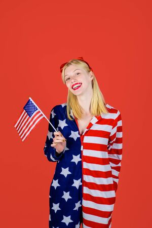 Happy blonde woman with little American flag.