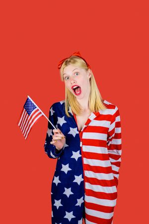 Make america great again! Independence Day. American flag. America. United states. USA. United states of America. US. July 4th. Summer. Surprised woman with little American flag. Stock Photo