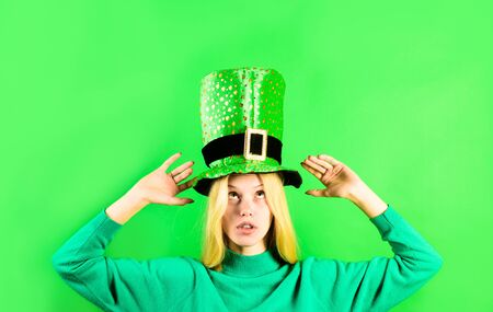 St Patrick Day. Green top hat. Blonde girl in in green top hat. Leprechaun. Green leprechaun. Green hat with clover. Saint Patrick's Day. Traditions of Saint Patrick Day. Sale. Discount. Ireland.