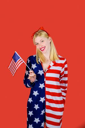 American flag. America. United states. USA. United states of America. US. July 4th. Summer. Happy woman holding American flag. Stock Photo