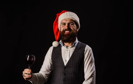 Santa man in waistcoat drink glass of red wine. Santa man tasting red wine. Bearded man tasting glass of wine. Degustation concept. New year party. Happy man drinking red wine.