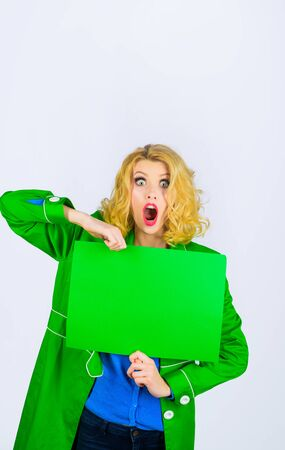 Surprised woman holding advertising board. Advertising and sale. Online shopping. Advertising banner. Seasons sale. Discount. Black friday. Marketing. Add. Copy space for text.