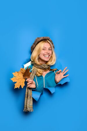Happy autumn girl showing ok sign. Season and autumn holiday. Autumn collection. Smiling girl shows ok sign. Winking girl. Girl with leaves looking through paper hole. Autumn time. Beauty and fashion