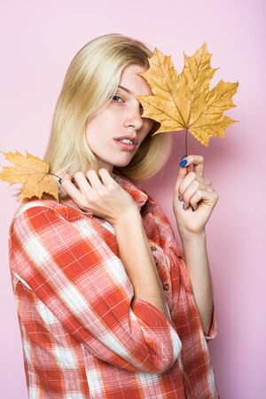 Sensual woman in casual wear with yellow leaves. Autumn woman with golden maple leaves. Fashion trends for fall. Autumn fashion. Blond girl with golden leaf. Autumnal mood. Autumn sales. Autumn woman Stockfoto