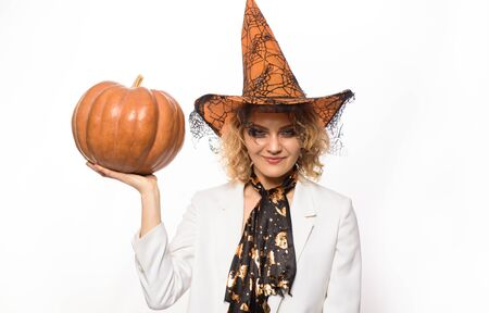 Blonde girl with Pumpkin. Halloween party. Happy halloween. Blonde girl in witch hat. 31 october. Trick or treat. Jack-o-lanterns