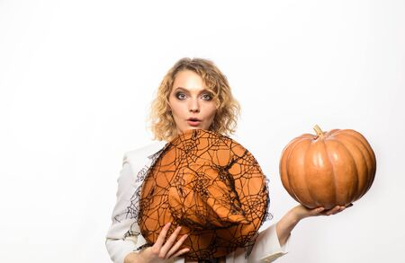 Halloween costume. Trick or treat. Happy woman with Pumpkin. Halloween party. Happy halloween. Blonde woman in witch hat. 31 october. Jack-o-lanterns. Autumn