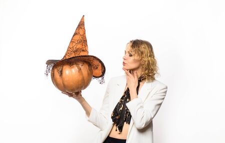 Halloween. Trick or treat. Happy woman with pumpkin. Happy halloween. Blonde woman in witch hat. 31 october. Jack-o-lanterns. Autumn Stockfoto - 128606391