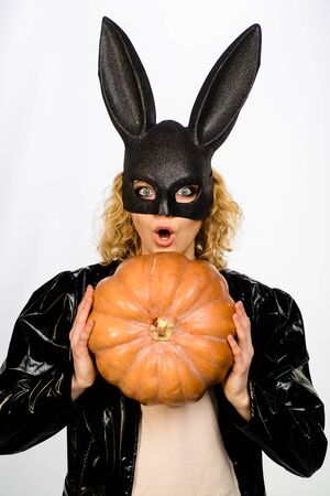 Trick or treat. Sexy girl with Pumpkin. Halloween party. Happy halloween. Blonde girl in witch hat. 31 october. Jack-o-lanterns. Bunny mask 写真素材