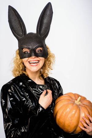 Trick or treat. Sexy smiling woman with pumpkin. Halloween party. Happy halloween. Blonde girl in bunny mask. 31 october. Jack-o-lanterns. Sexy Halloween costume
