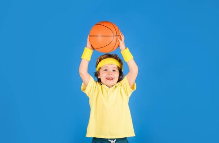 Basketball training. Cute boy playing basketball. Sport game. Kid activities. Little basketball. Sports equipment. Active lifestyle. Sport Stock Photo