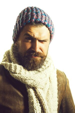 Handsome bearded man wearing winter hat and scarf. People, lifestyle, seasons, fashion and clothing concept. Autumn or winter fashion. Fashionable demi-season clothing. Stylish man wrapped in scarf 写真素材