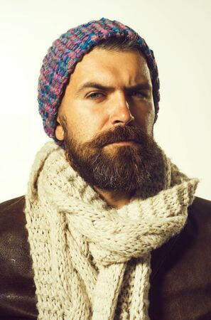 Male winter fashion. Fashionable handsome bearded man in hat. Handsome man wearing demi-season clothing. Advertise autumn-winter fashion. Trendy look. Casual bearded man in jacket, scarf and cap