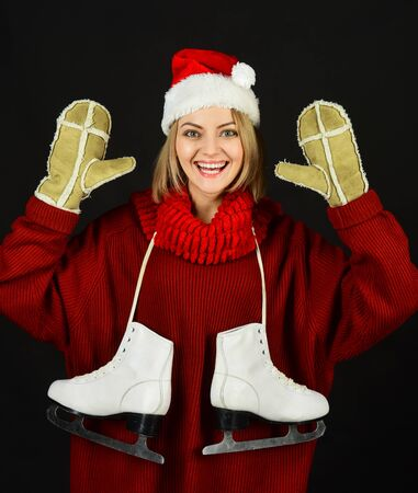 Happy lady with skates. Enjoying winter sport. Ice skating woman. Smiling girl wearing warm winter clothes goes ice-skating. Pretty girl with figure skates. Winter sport activity, weekends, holidays.