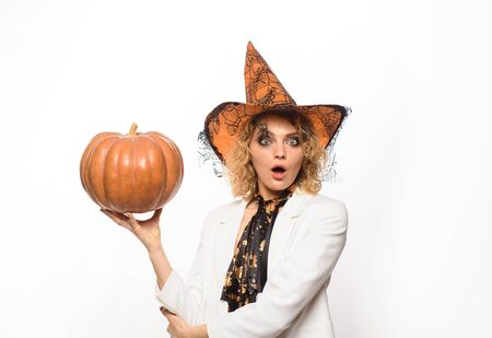 Trick or treat. Woman with Pumpkin. Halloween party. Happy halloween. Blonde woman in witch hat. 31 october. Jack-o-lanterns. Autumn