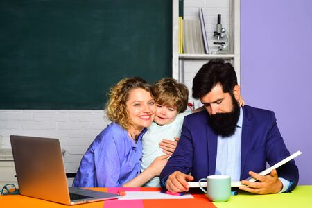 Pupil learning letters and numbers with parents. Mother father and son together schooling. Education for kids out of school. Boy from elementary school. Education concept. Little boy and his parents