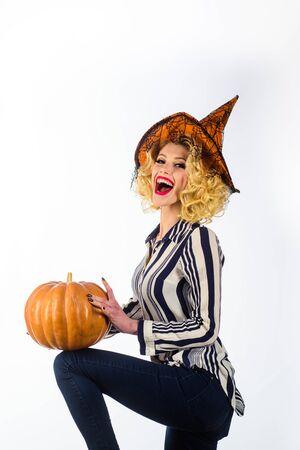 Halloween people in witch costume. Happy Halloween Witch with Pumpkin. Trick or treat. Halloween Party girl. Happy Halloween Weekends. Imagens