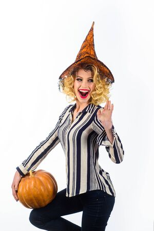 Happy Halloween Witch with Pumpkin. Trick or treat. Halloween Party girl. Happy Halloween Weekends. Young girl with Pumpkin. Party and traditional food. Magic hat. Halloween people in witch costume Imagens