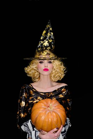 Halloween party. Halloween woman in witch costume with jack o lantern. Preparation halloween holidays. Woman witch with pumpkin. Happy Halloween. Autumn mood. Sensual girl in witch hat with pumpkin