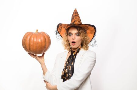Surprised woman in witch halloween costume with jack o lantern. Preparation Halloween holidays. Woman witch with pumpkin. Halloween party. Happy Halloween. Girl in witch hat with pumpkin Imagens