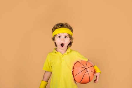 Active lifestyle. Basketball training game concept. Surprised boy playing basketball. Stock Photo