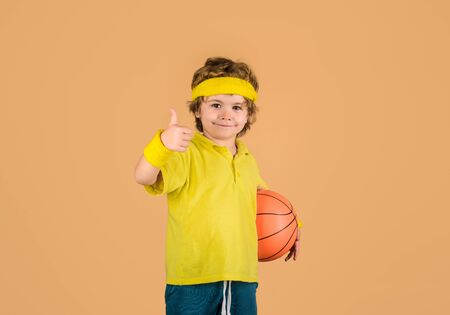 Active sports lifestyle. Basketball game concept. Cute boy playing basketball.