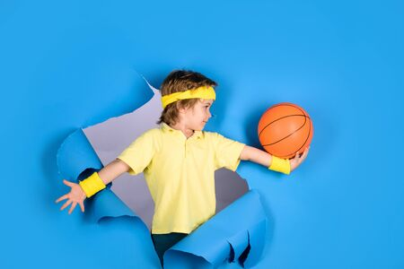Sportsman boy hold ball on hand. Enjoy sports game. Sports equipment. Kid sport activities. Stock Photo