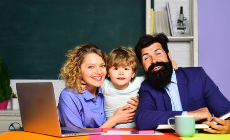 Parents helps child boy. Parents teaching kids private lessons in math. Back to school. Home schooling.