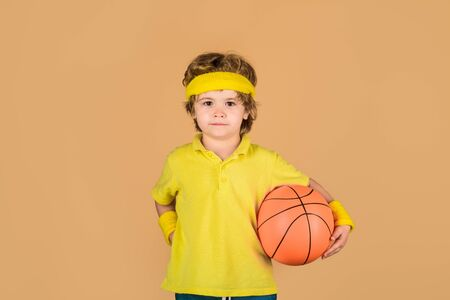 Active sports lifestyle. Basketball training game concept. Cute boy playing basketball. Stock Photo