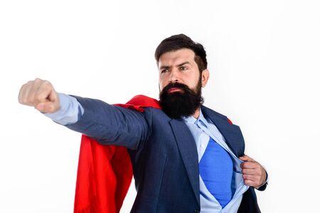 Superhero in red cape showing blue shirt. Business. Enthusiasm. Super businessmen. Business concept.