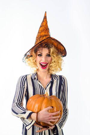 Trick or treat. Woman huggs Pumpkin. Halloween party. Happy halloween. Blonde woman in witch hat.