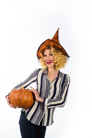 Trick or treat. Halloween Party girl. Happy Halloween Weekends. Young girl with Pumpkin. Party and traditional food. Imagens