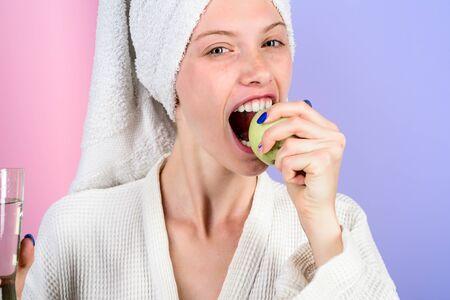 Smiling girl biting organic apple. Healthy eating full of vitamins. Woman eating apple. Healthy nutrition. Diet. Young woman is eating apple. Healthy eating concept. Vegetarian, vegan, raw concept. Imagens
