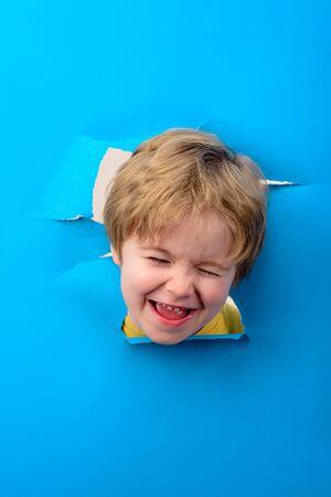 Happy child. Child breaking through paper. Happy kid. Boy through paper. Season sale. Breaking paper. Sale. Discount.