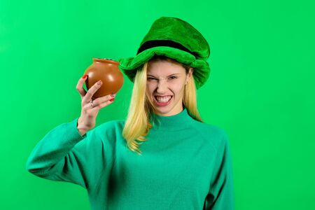Patricks Day. Girl in green hat holds pot with gold. Saint Patrick's Day girl. Leprechaun. Irish Traditions. Green top hat. Green hat with clover. Leprechaun costume. Clover.