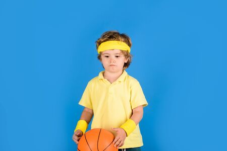 Boy playing basketball. Sports equipment. Sport game. Kid activities. Stock Photo