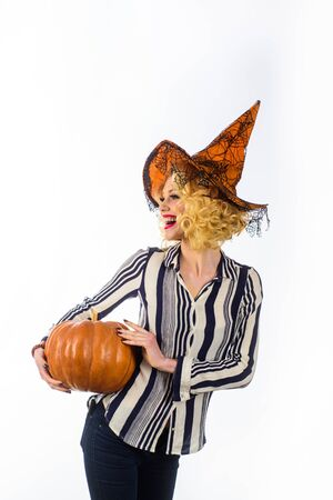 31 october. Happy Halloween. Woman in witch hat with pumpkin. Halloween party. Trick or treating. Girl in witch hat.