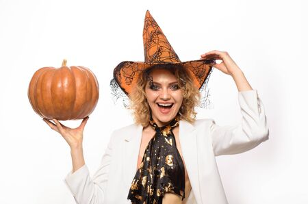 Emotional woman in witch halloween costume with jack o lantern. Preparation Halloween holidays. Woman witch with pumpkin. Halloween party. Happy Halloween. Sensual girl in witch hat with pumpkin Imagens