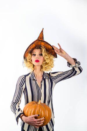 Witch. Celebration autumn holiday halloween. Trick or treat. Halloween witch in magic hat. Beautiful woman in witches hat with pumpkin. Happy Halloween. Halloween horror concept. Witch in magic hat