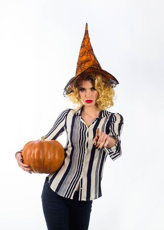 Halloween girl with pumpkin. Celebrating Halloween. Happy witch with Jack-o-lantern. Happy Halloween weekend. Witch concept. Halloween witch with magic pumpkin. Trick or treat. Magic witch girl Imagens