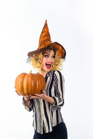 Girl in witch hat. Trick or treat. Halloween witch with pumpkin. Holiday halloween carnival costume. Witch magic. Jack-o-lantern. girl in halloween costume. Witch hat. Wizard. Secrets of magic