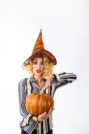 31 october. Happy Halloween. woman in witch costume hold pumpkin. Halloween dress. Witch costume and hat. Jack-o-lantern. Halloween carnival, masquerade. Halloween art. Magical witch girl in hat