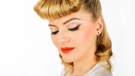 Cosmetics, skincare, make-up and visage. Retro vintage beauty female. Retro hairstyle. Beautiful woman with bright makeup. Reklamní fotografie