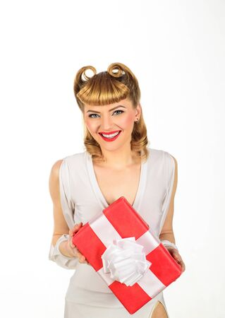 Gorgeous pin up girl with gift box. Birthday concept. Fashion in retro style. Woman with present.