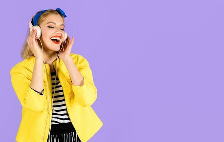 Woman with headphones listening music. Sexy girl in yellow jacket. Woman enjoy good sound. Girl relaxing listening to favorite modern music with headphones.