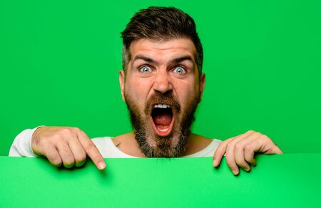 Screaming man holding advertising board. Advertising and sale. Online shopping. Advertising banner. Stock Photo