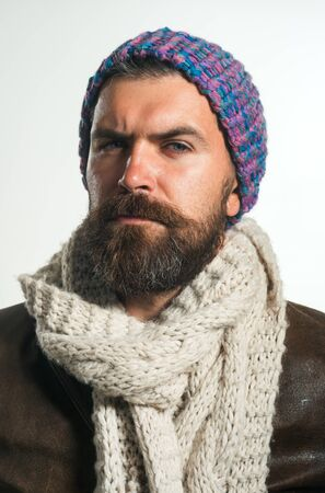 People, lifestyle, seasons, fashion and clothing concept. Autumn or winter fashion. Fashionable demi-season clothing. Stylish man wrapped in scarf.