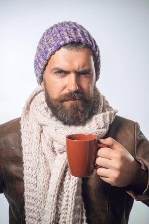 Happy bearded man drinking morning espresso coffee. Caucasian handsome male business professional having coffee.