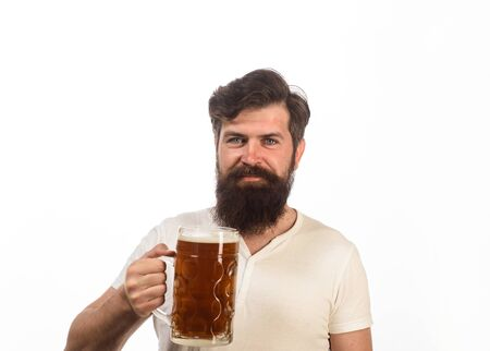 Stylish handsome man drinking beer of glass on party. Beer pub. Cheerful bearded drunk hipster male drinking craft beer from mug. Brewing. Stylish guy at cafe pub. Beer time. Alcohol, harmful habits